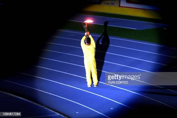 A Salvadoran athlete lights the fire during the opening ceremony of the XIX Central American and Caribbean Games 23 November 2002 in San Salvador AFP...