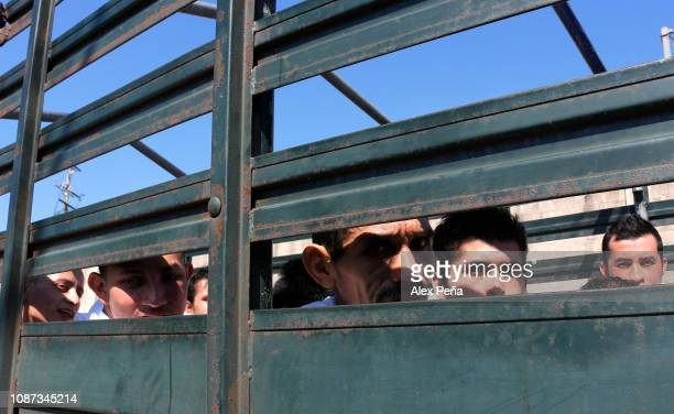 Salvadoran convicts arrive in a Salvadoran Armed Forces truck to the maximum security prison during the transfer of prisoners from different...