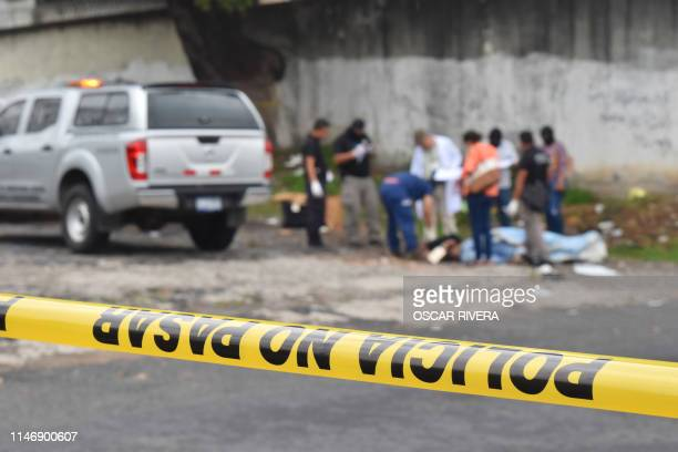 Salvadoran forensic police work at a crime scene where a man was murdered in San Salvador on May 29 2019 El Salvador recorded 3340 homicides in 2018...