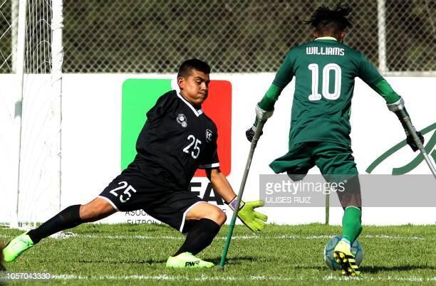 Salvadoran goalkeeper Milton Andasol tries to stop Nigerian player Monday Williams during their 2018 Amputee Football World Cup match in San Juan de...