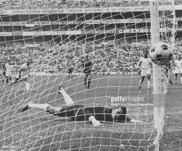 Salvadoran goalkeeper Raúl Magaña is beaten by a shot from Wilfried Van Moer of Belgium in the 12th minute of their World Cup Group 1 match at the...