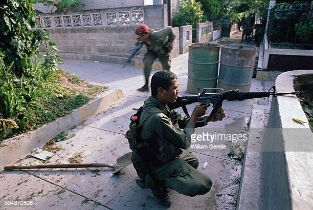 Salvadoran government soldiers fight in the street against antigovernment guerrillas during a rebel offensive