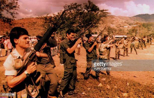 Salvadoran guerrillas unload their guns in the air El Salvador 14 December 1992 before surrendering them for destruction under the supervision of...