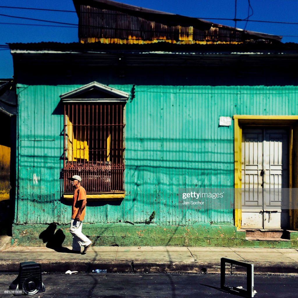 Spanish colonial architecture in contemporary housing in el salvador a salvadoran man walks in front of a common lower middle class house designed by freerunsca Image collections