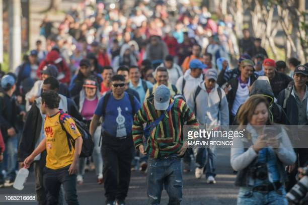 Salvadoran migrants begin their journey in caravan heading the United States in San Salvador on November 18 2018 The migrants are mostly fleeing...
