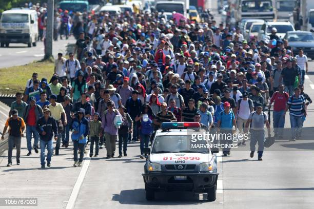 TOPSHOT Salvadoran migrants embark on a journey in caravan to the United States in San Salvador on October 31 2018 Many Salvadoreans inspired by the...