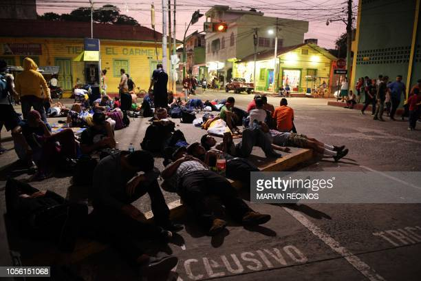 Salvadoran migrants heading in a caravan to the US rest during a stop on their journey in Ciudad Tecun Uman Guatemala on the border with Mexico on...