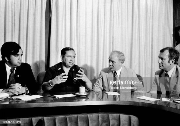 Salvadoran Minister of Defense General José Guillermo García, second left, along with members of a U.S. Congressional delegation, speaks at a press...