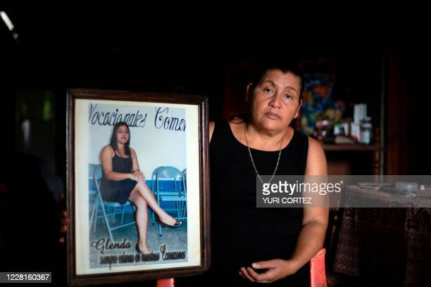 Salvadoran Mirna del Carmen Solorzano poses with a photo of her daughter Glenda, during an interview at her home in Jayaque, La Libertad, El Salvador...