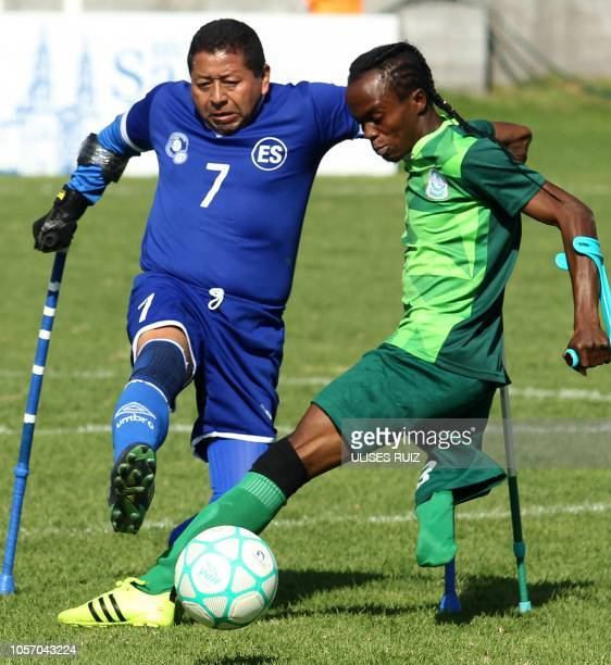 Salvadoran player Jose Nava a former soldier who lost his leg on a land mine vies for the ball with Nigerian player Anstor Nausa during their 2018...