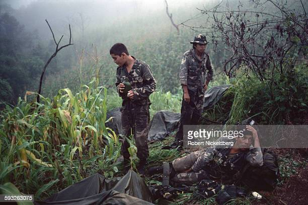 Salvadoran soldiers from the Atlacatl Rapid Reaction Battalion wake in the early morning of fog enveloped hills before moving into position against...