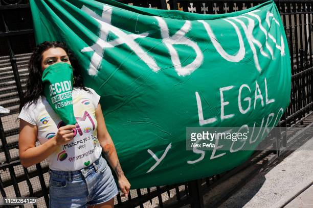 Salvadoran woman poses next to banner that demands legality of abortion during a demonstration as part of the International Women's Day on March 8...