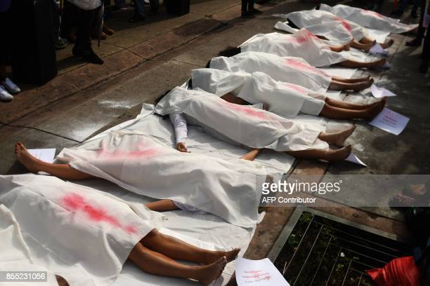 Salvadoran women carry out a performance during a demonstration claiming for the decriminalization of abortion in San Salvador on September 28 2017 /...