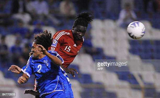Salvadorean Alexander Escobar vies for the ball with Trinidad Tobago's Kenwyne Jones during their FIFA World Cup South Africa2010 qualifying football...