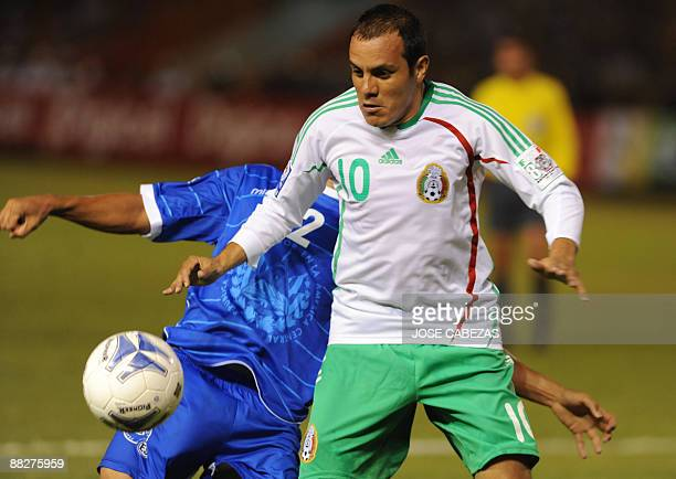 Salvadorean Alexander Escobar vies the ball with Mexican Cuautemoch Blanco during their FIFA World Cup South Africa2010 qualifier on June 6 2009 at...