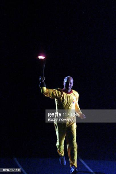 Salvadorean athlete Miguel Mertz carries the torch with the Central American flame during the opening ceremony of the XIX Central American and...