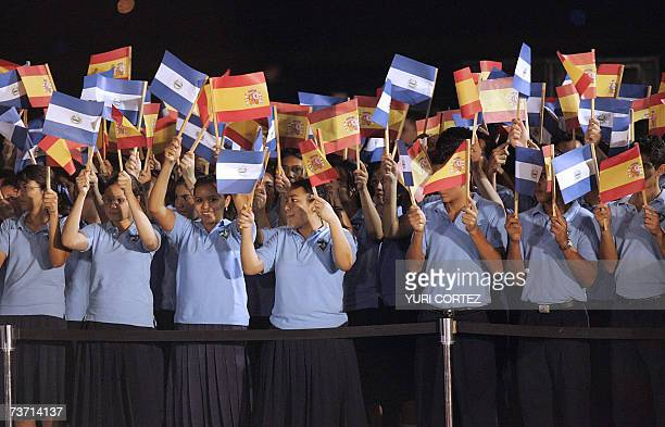 Salvadorean Children wave Spanish and Salvadorean flags as the Spanish royal couple arrive at the El Salvador's international airport in Comalapa El...