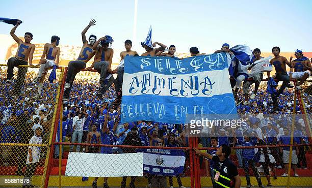 Salvadorean fans cheer their team during the FIFA World Cup South Africa 2010 qualifier match against the USA at the Cuscatlan stadium in San...