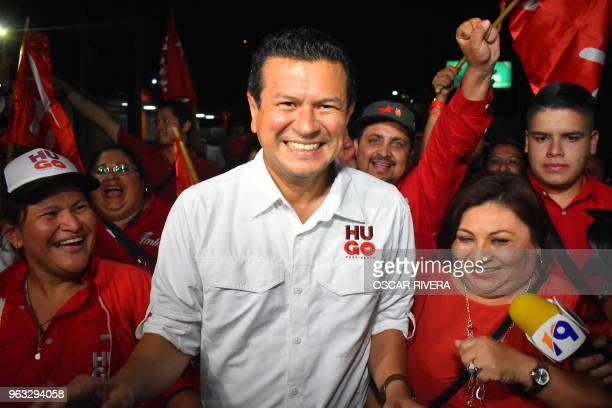 Salvadorean Foreign Minister Hugo Martinez of the leftist Frente Farabundo Marti for National Liberation party celebrates with supporters after being...