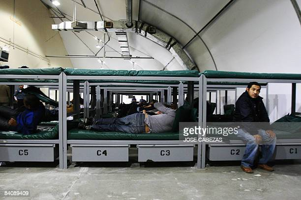 Salvadorean illegal immigrants await for breakfast in their barracks at Willacy Detention facility in Raymondville Texas on December 18 2008 early...