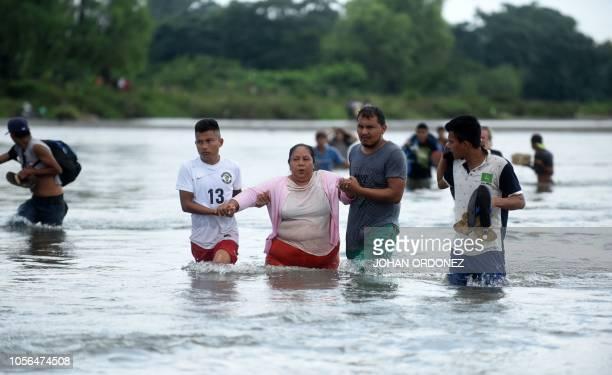 Salvadorean migrants heading in a caravan to the US arrive in Ciudad Hidalgo Mexico after crossing the Suchiate River from Ciudad Tecun Uman...