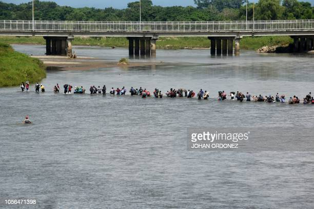 Salvadorean migrants heading in a caravan to the US cross the Suchiate River from Guatemala to Mexico as seen from Ciudad Hidalgo Mexico on November...