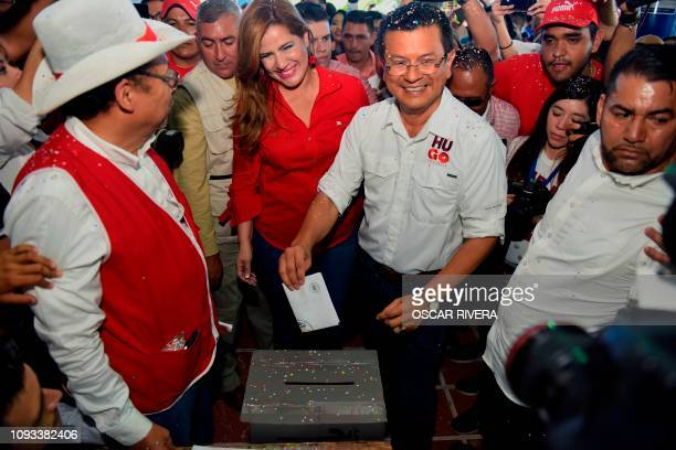 Salvadorean presidential candidate Hugo Martinez , of the Farabundo Marti National Liberation Front , accompanied by his running mate Karina Sosa ,...