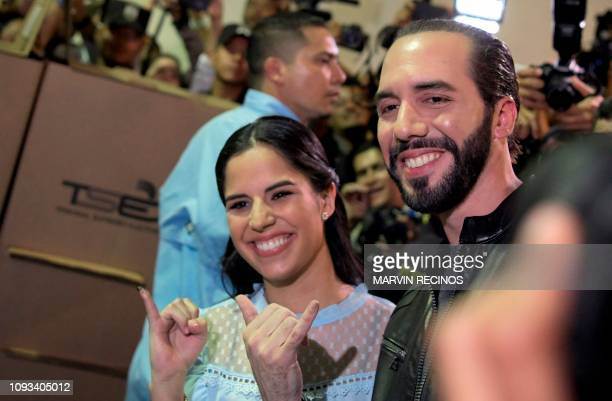 TOPSHOT Salvadorean presidential candidate Nayib Bukele of the Great National Alliance and his wife Gabriela Rodriguez pose after voting during the...
