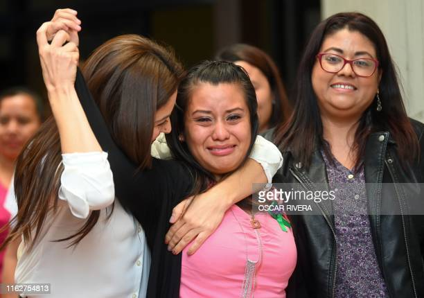 Salvadorean rape victim Evelyn Hernandez celebrates with her lawyers after being cleared of murder after giving birth to a stillborn baby at home in...