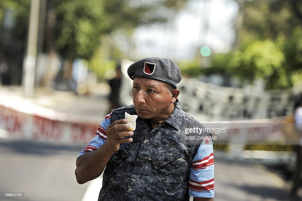 A Salvadorean veteran of the civil war (1980 to 1992) eats bread during a march in San Salvador, on January 15, 2013, on the 21st. anniversay of the peace agreements. Veterans marched to demand the pay of better pensions. AFP PHOTO/ Jose CABEZAS