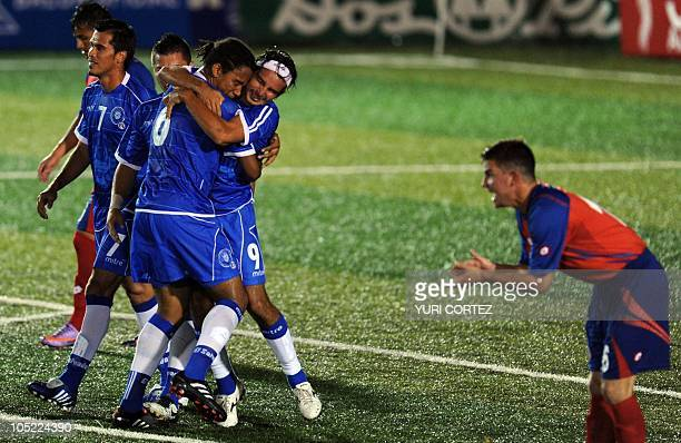 Salvadoreans Ramon Sanchez Shawn Martin and Rafael Burgos celebrate after scoring against Costa Rica in front of Costa Rican Gabriel Badilla during a...
