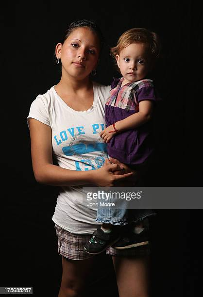 Salvadorian immigrant Stefanie Elizabeth holds her daughter Emily Nicole, 18 months, while spending another night at the Hermanos en el Camino...