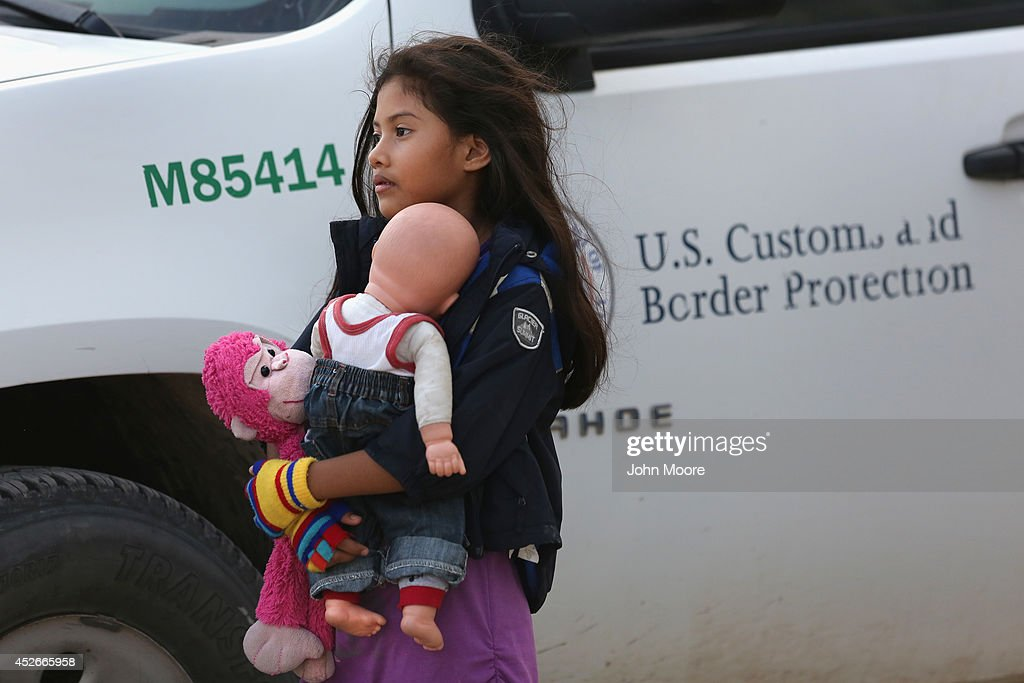 Salvadorian immigrant Stefany Marjorie, 8, holds her doll Rodrigo while going home on July 24, 2014 in Mission, Texas. Tens of thousands of immigrant families and unaccompanied minors from Central America have crossed illegally into the United States this year and presented themselves, with documents showing their nationalities, to federal agents, causing a humanitarian crisis on the U.S.-Mexico border. Texas' Rio Grande Valley has become the epicenter of the latest immigrant crisis, as more of them enter from Mexico into that sector than any other stretch of the America's 1,933 mile border with Mexico.