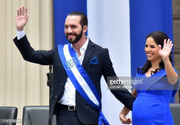 Salvador's new president Nayib Bukele waves along with his wife Gabriela Rodriguez during his inauguration ceremony at Gerardo Barrios Square outside...