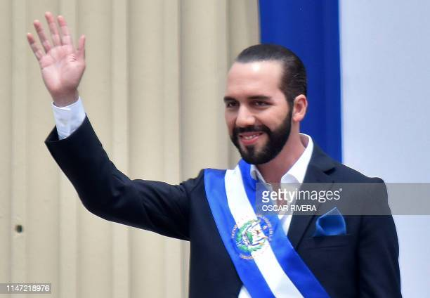 Salvador's new president, Nayib Bukele, waves during his inauguration ceremony at Gerardo Barrios Square outside the National Palace in downtown San...