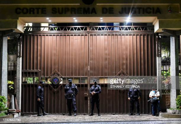 Salvadors Police officers stand guard in front of the Supreme Court of Justice in San Salvador, on May 2, 2021. - El Salvador's new Congress,...
