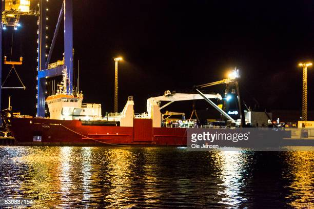 A salvage vessel arrives a Copenhagen Harbor with the privately owned and built submarine Nautilus which sank near Copenhagen Friday morning and...