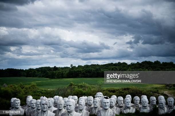 TOPSHOT Salvaged busts of former US Presidents can be seen at a mulching business where they now reside on August 25 in Williamsburg Virginia Howard...