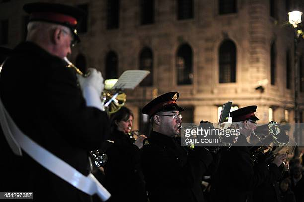 A Salvation Army band plays as it leads a torchlit procession to Trafalgar Square in central London on December 8 with the Choir and Clergy of St...