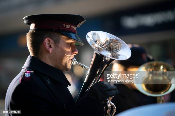 A salvation Army band plays Christmas carols as shoppers make their last minute purchases on Christmas Eve on December 24 2018 in Birmingham England...
