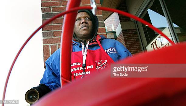 Salvation Army bell ringer Juanita Brown works near her red Holiday donation kettle December 20 2005 in Park Ridge Illinois Since 1865 the Salvation...