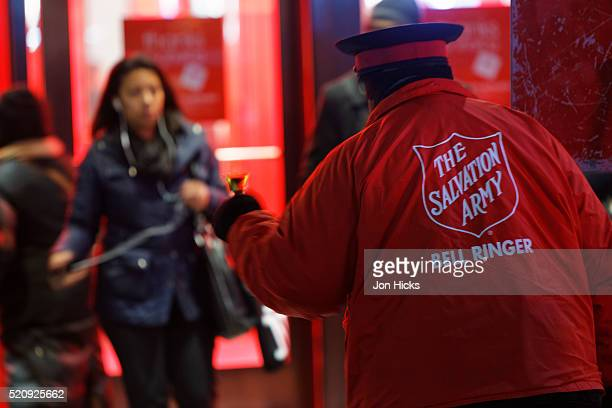 A Salvation Army bell ringer outside Macy's during The Holidays, New York City.
