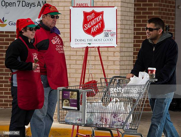 Salvation Army bell ringer volunteers William Schmidt who is on his 20th year volunteering and his grandson Bubba Wellens ring their bells hoping for...