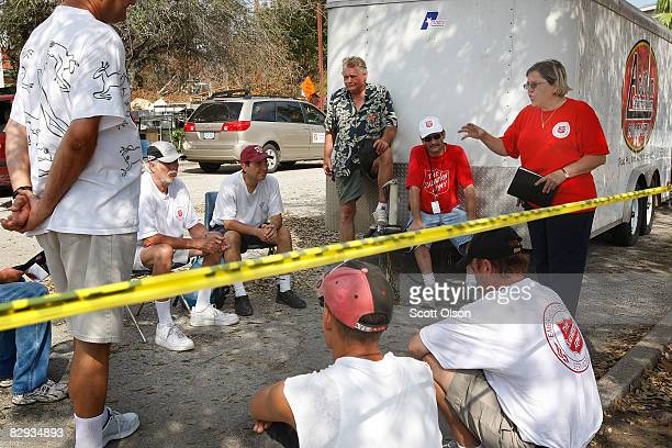 Salvation Army Maj Elda Flores holds Sunday service in the parking lot since the building was flood damaged during Hurricane Ike September 21 2008 in...