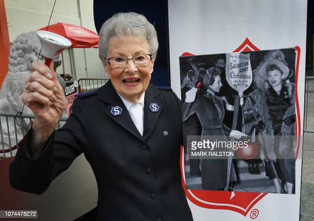Salvation Army officer Barbara Newbould who is 92 years old holds a 1947 portrait of herself with actress Lucille Ball as she is honored with a...
