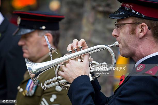salvation army trumpeter plays the last post - salvation army stock photos and pictures