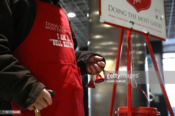 Salvation Army volunteer bell ringer San Arnold rings bells as he solicits donations at the Powell Street Bay Area Rapid Transit station on December...