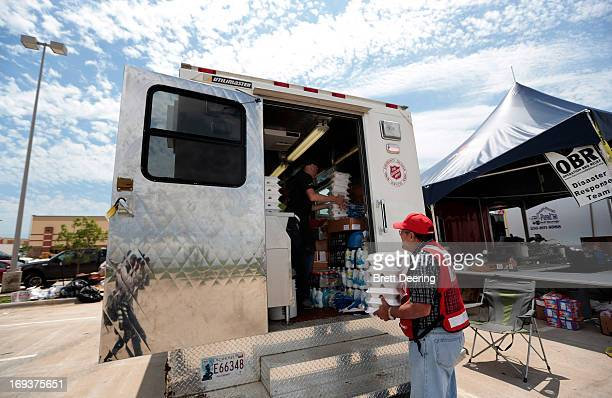 Salvation Army volunteers load a food distribution truck for victims of the May 20 tornado May 23 2013 in Moore Oklahoma The tornado of at least EF4...