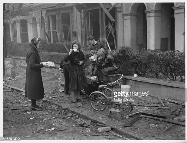 Salvation Army workers take a muchneeded tea break while salvaging pieces of furniture from the bombed ruins of homes in Dulwich England