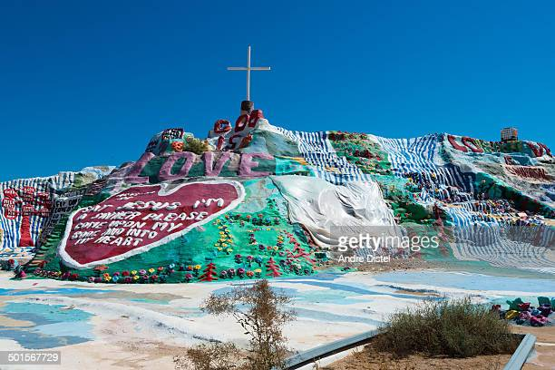 CONTENT] Salvation Mountain is an art installation covering a hill in the Colorado Desert north of Calipatria near Slab City and several miles from...